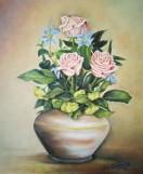 Jarrón con tres rosas color rosas